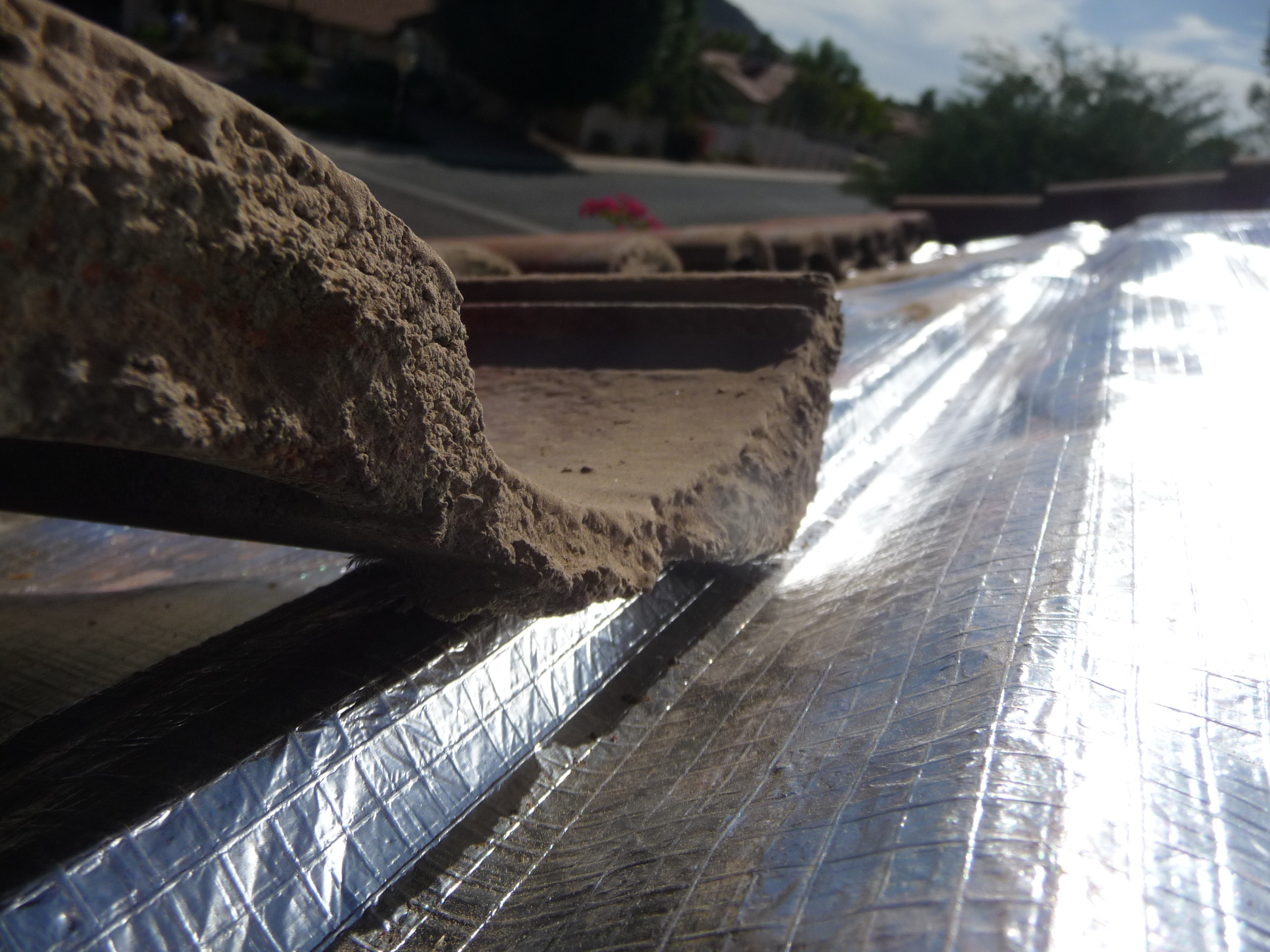 Exceptional Roof Tile Being Reinstalled Over The TCM Roof Underlayment System. Notice  The